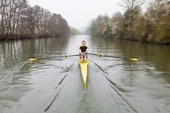 man rowing on the river avon - stock photo