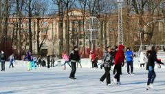 People are skating on the open skating ring in winter Stock Footage