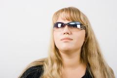 Girl in sunglasses Stock Photos
