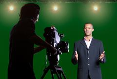 presenter piece to camera in tv studio - stock photo