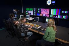 Crew in tv broadcast gallery Stock Photos