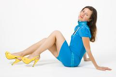 Girl in a bright dress posing in studio Stock Photos