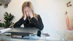 Stressed woman works on laptop Stock Footage
