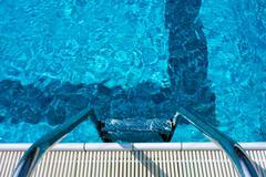 Swimming pool ladder Stock Photos