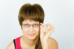 surprised girl in glasses - stock photo