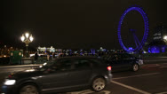 London Eye at night with Westminster Bridge traffic Stock Footage