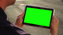 Man Holds Blank Green Screen Tablet PC Outside Stock Footage