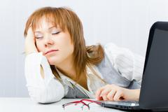 worker, asleep on a laptop - stock photo