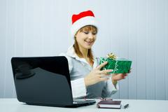 working girl in santa hat with a gift - stock photo