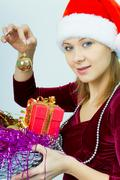smiling girl in santa hat - stock photo