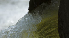 Polluted yellow water out of drainage pipe Stock Footage
