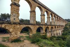 roman aqueduct pont del diable in tarragona, spain - stock photo
