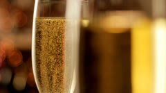 Glasses of Champagne rack focus Stock Footage