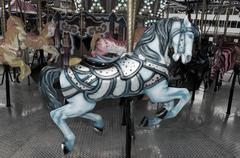 blue carousel horse - stock photo