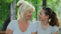 beautiful mother and daughter hugging and laughing - stock footage