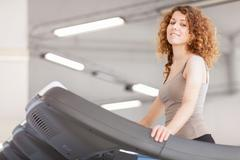 woman is doing workout on a treadmill - stock photo