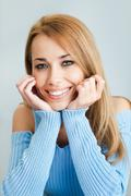 Woman looking at camera and smiling Stock Photos