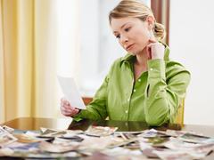 woman looking at photos - stock photo