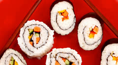 Japanese Cuisine : Sushi Maki Roll on red plate Stock Footage