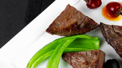 Meat savory : grilled beef fillet mignon on white plate over bla Stock Footage