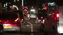 London traffic at night with black cabs and red buses - stock footage