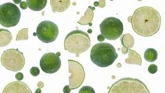 Falling Limes (ends on blue) Stock Footage