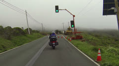 Road construction follow motorcycle foggy California road HD 073 Stock Footage