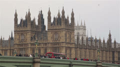 Parliament and Westminster Bridge with buses and people - stock footage