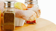 Fresh raw chiken legs and spices Stock Footage