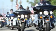Stock Video Footage of Harley Davidson Motorcycle Bikers Parade Ride Down the Road in America