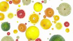 Citrus fruits falling down (ends on blue) Stock Footage