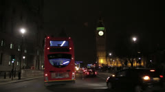 Parliament at night from Parliament Square with traffic and double decker bus - stock footage