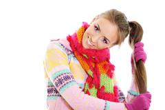 portrait of a beautiful happy woman in a knitted jacket - stock photo