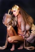 Sexual model in a fur coat Stock Photos