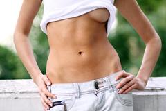 topless young woman in a blue jeans - stock photo