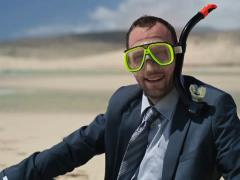 Happy businessman in diving mask on the beach NTSC Stock Footage