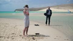 Business people talking on cellphone on beautiful beach HD Stock Footage
