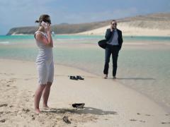 Business people talking on cellphone on beautiful beach NTSC Stock Footage