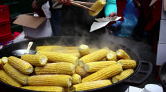 Street Vendor Grilled Corn / Money Changing Hands - stock footage