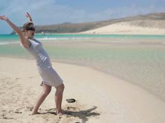 Happy, excited businesswoman enjoying beautiful beach NTSC Stock Footage