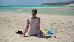 Businesswoman relaxing on beautiful beach HD Stock Footage