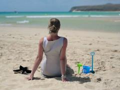 Businesswoman relaxing on beautiful beach NTSC Stock Footage