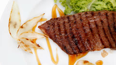 Roast steak boneless with roast onion Stock Footage