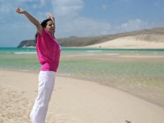 Happy, excited young woman relaxing on beautiful beach NTSC Stock Footage