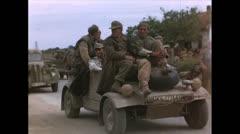 WW2-Color720p-ItalienPrisenersWaitingInKuebelwagen01 Stock Footage