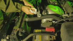Mechanic wrench looking at engine grease monkey Stock Footage