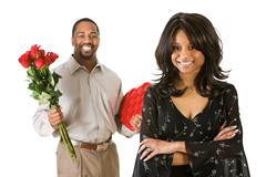 Stock Photo of couple: woman with boyfriend and gifts in background