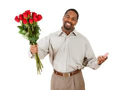 Couple: man holds bouquet of flowers Stock Photos