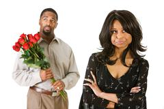 couple: man with flowers to apologize - stock photo