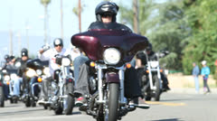 Harley Davidson Motorcycle Bikers Parade Ride Down the Road in America  Stock Footage